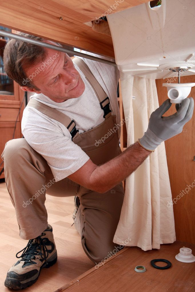 Plumber repairing faucet piping  Stock Photo #7376305