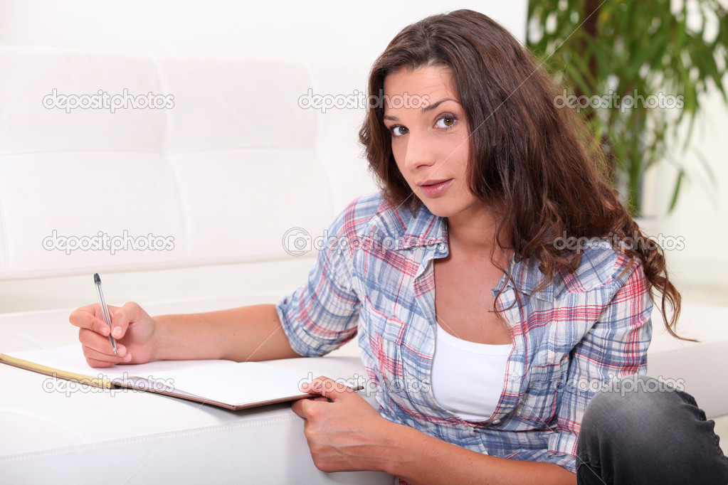 Girl with diary indoors — Stock Photo #7377285