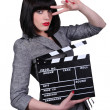 Stylish woman with a movie clap board - Stock Photo