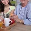 Mother and daughter having breakfast — Stock fotografie