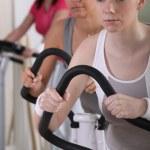 Sporty women on cross trainers — Stock Photo