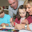 Grandparents spending time with their grandchildren - Stock Photo