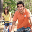 Young riding bikes — Stock Photo #7389640