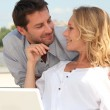 Happy couple relaxing outdoors — Stock Photo