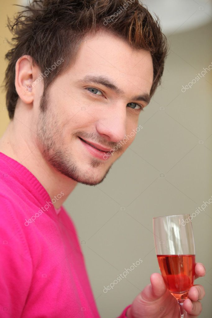 Young man drinking wine — Stock Photo #7388664