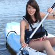 Stock Photo: Teenage girl in row boat