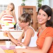 Stock Photo: Young women having breakfast together