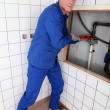 Royalty-Free Stock Photo: Plumbing repairing pipes in a bathroom