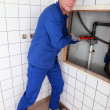 Plumbing repairing pipes in a bathroom — Stock Photo