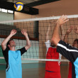 Volleyball players on indoor court — Stock Photo #7390429