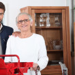 Handyman helping out a senior woman at home — Stock Photo #7390468