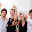 Two young couples drinking champagne at Christmas — Stock Photo