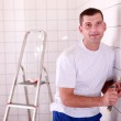 Electrician wiring a large tiled room — Stock Photo #7391189