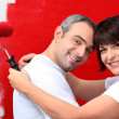Couple of diy painting it red — Stock Photo