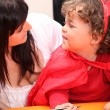 Mother and cute child disguised as devil — Stock Photo