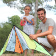 A father and his daughter with a kite — Stock Photo