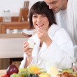 Royalty-Free Stock Photo: Couple in bathrobe having breakfast