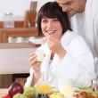 Couple in bathrobe having breakfast — Stock Photo