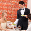 Couple being served their meal - Stock Photo