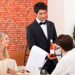 Young couple choosing rose wine in a restaurant — Stock Photo