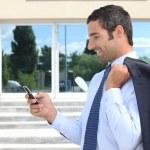 Businessman sending text message — Stock Photo