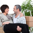 Mcarrying his partner over threshold of their new home — Stock Photo #7392617