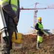 Surveyors on a construction site - Stock Photo