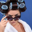 Young woman in hair rollers and sunglasses — Stock Photo #7393287