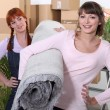 Stock Photo: Girls moving in together