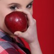 Woman with a red apple — Stock Photo #7393632