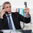 Businessmon two telephone calls — Stock Photo #7393694
