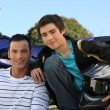 Father and son stood by motorbike — Stock Photo #7394633