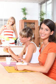 Young women having breakfast together — Stock Photo