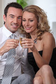 Midshot of couple drinking champagne — Stock Photo