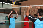Volleyball players on indoor court — Stock Photo