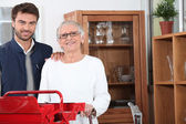 Handyman helping out a senior woman at home — Stock Photo