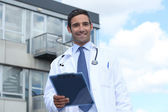 Doctor standing outside a hospital — Stock Photo