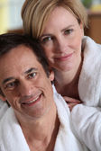 Portrait of a couple in their bathrobes — Stock Photo