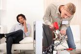 Female technician repairing a television — Stock Photo