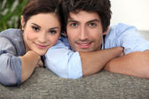 Young couple on a sofa — Stock Photo