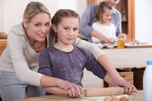 Mother and little girl cooking together — Stock Photo