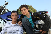 Father and son stood by motorbike — Stock Photo