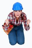 Tradeswoman waiting in anticipation — Stock Photo