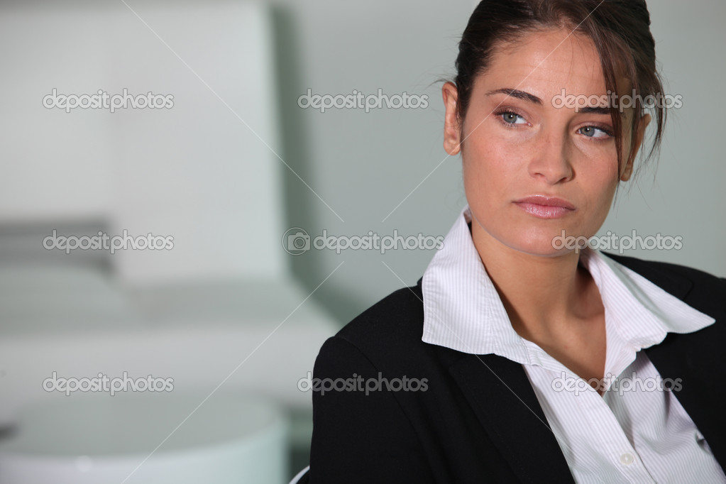 Closeup of a serious young businesswoman — Stock Photo #7390262