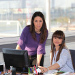 Two women at work - Stock Photo