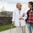 Woman strolling with an elderly lady — Stock Photo