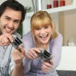 Royalty-Free Stock Photo: Couple playing video games at home