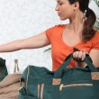 Foto Stock: Brunette with kit bag
