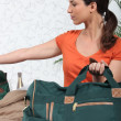 Stock Photo: Brunette with kit bag