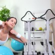 Stock Photo: Young womdoing abdominal exercises in gym